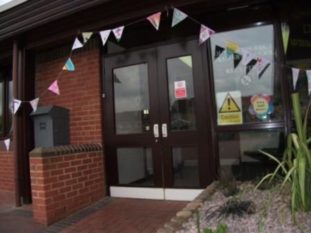 Bunting expressing hopes surrounds the school