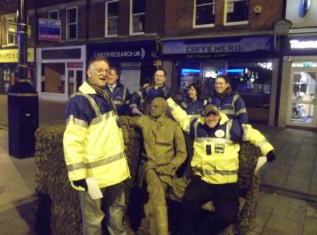 Street Angels gather at a statue