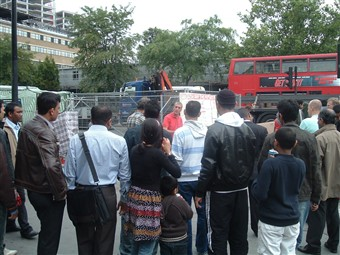 Crowds gather and listen to a street evangelist