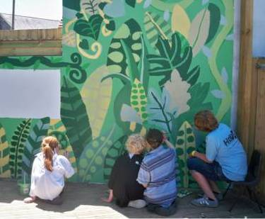 Children painting a mural: HOPE Brighton '11